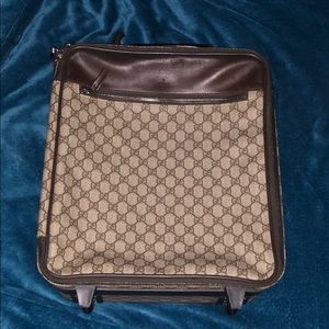 Authentic Gucci roller carry-on with handle
